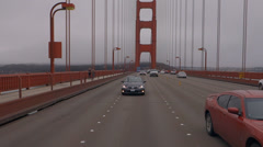 Midspan Golden Gate Bridge Leaving San Francisco Traffic Rear POV Stock Footage