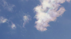 Multicolored Wispy Clouds with Floating Sprites - stock footage