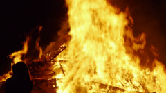 Large bonfire flames against night sky tilt Stock Footage