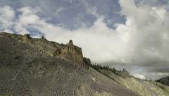 Pan Right Wide Angle Rocky Battlements of Ancient Giants and Stormy Stock Footage