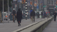 People Walking Jogging While Traffic Goes by Foggy Morning Embarcadero Stock Footage
