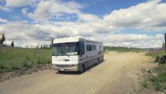 Recreational Vehicle Entering Chicken, Alaska - Jib Up to Chicken St - stock footage