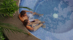 Couple having cocktail in hot tub, overhead shot - stock footage