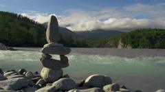 Riverside Cairn on Rocky Shore in Alaska Time Lapse Stock Footage