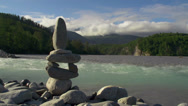 Stock Video Footage of Riverside Cairn on Rocky Shore in Alaska Time Lapse
