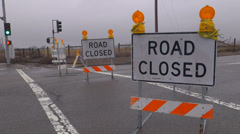 Stock Video Footage of Road Closed Sign Danger Warning Intersection Rainy Flooding Close