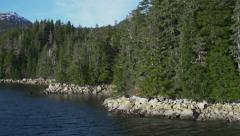 Rocky Shoreline Side Mountain Reveal from Ferry Southeast Alaska Stock Footage