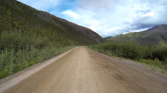 Running Along the River on Dempster Highway Yukon Territory Driving Stock Footage