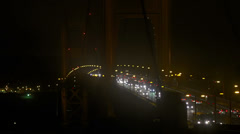 Rush Hour Traffic Buses and Cars Foggy Golden Gate Bridge Night Time Stock Footage