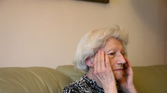 Elderly woman with headache, grandma having migraine, severe pain, indoors Stock Footage