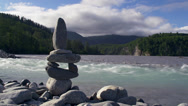 Stock Video Footage of Rushing Creek Water and Rock Cairn Alaskan River Scenic