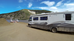 RV Towing Car Loading onto George Black Ferry to Cross Yukon River t Stock Footage