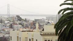 San Francisco Foggy Rooftops City Bay Bridge Scenic Pan Left Stock Footage