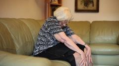 Elderly woman suffering after knee surgery, grandma having pain, massage Stock Footage