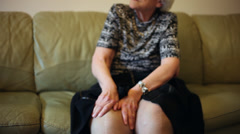 Elderly woman suffering after knee surgery, grandma having pain, scar, massage Stock Footage