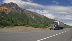 Semi Truck Passing Long Haul Low Angle Alaska Highway Mountain Sceni Stock Footage