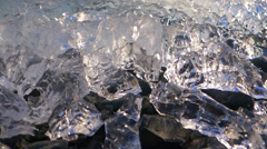 Shattered Glowing Ice on Rocky Beach dolly Stock Footage