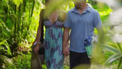 Couple looking watching monkeys in tropical jungle, Costa Rica Stock Footage