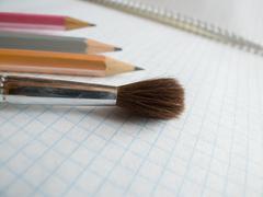 brush on copybook - stock photo