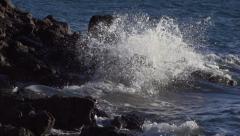 Slow Motion Waves Splashing on Jagged Rocks Stock Footage