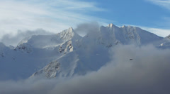 Stock Video Footage of Small Plane Flying Past Big Snowy Mountains Alaska