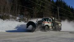 Snowplow Truck on Sunny Day Passing By Fast Stock Footage