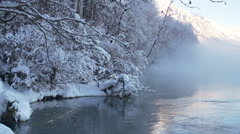 Snowy Icy Winter Boughs and Branches over Misty River in Alaska Stock Footage