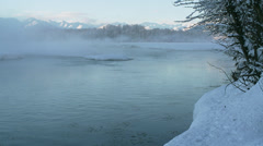 Steaming Waters of Chilkat River with Snowy Riverbank and Distant Al Stock Footage