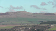 Stock Video Footage of Elevated view of Sidlaw Hills and Kingsway Retail Park Dundee Scotland