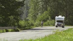 Summertime Bicyclist RV Fast Passing Danger Heat Waves Stock Footage