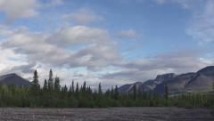 Summertime Dry Riverbed Cloudy Evening in Alaskan Mountains pan right Stock Footage