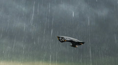 Alien UFO Spacecraft fly in stormclouds with lightning and rain - stock footage
