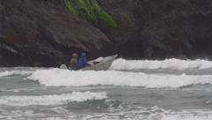 Three People in Open Skiff Motorboat in Ocean Surf Waves by Cliff Sl Stock Footage