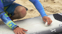 Applying wax on a surfboard Stock Footage