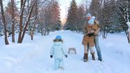 Stock Video Footage of Young family playing in the park in winter