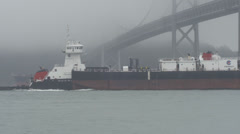 Two Large Cargo Freight Ore Tanker Ships Passing Under SF Bay Bridge Stock Footage