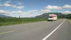 Uhaul Moving Truck and Car Pass by on Alaskan Scenic Highway Tok Cut Stock Footage