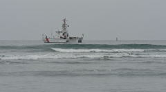 US Coast Guard Patrol Boat Barracuda Offshore Past Breakers with Buo Stock Footage