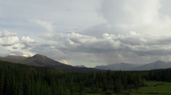 Vast Yukon Territory Mountains Valley Forest Rain Clouds Timelapse Stock Footage