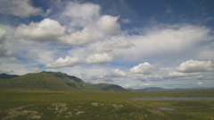 Vast Yukon Tundra Hills and Lake Cloudy Timelapse HD Stock Footage