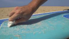 CLOSE UP: Applying wax on a surf Stock Footage