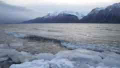 Winter Shoreline Chilkat Inlet Alaska Tilt Up Waves and Ice to Mount Stock Footage