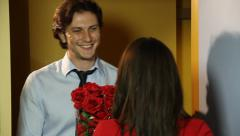 Young man comes to door with roses on Valentine, gets rejected Stock Footage