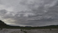 Stock Video Footage of Yukon Dry Riverbed and Distant Hills Cloudy