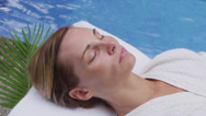 Stock Video Footage of Woman at spa lays by pool
