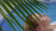 Stock Video Footage of Woman at spa laying by pool