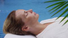 Woman laying by pool at spa, Cost Rica - stock footage