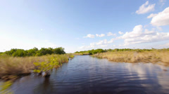 Hi speed airboat ride in the Everglades Stock Footage
