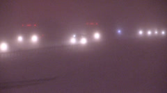 Heavy snow and blowing snow on highway at night v10 Stock Footage