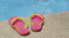 Sandals laying by pool, Costa Rica Stock Footage